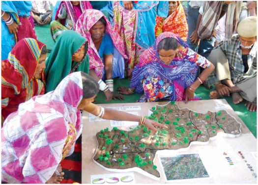 Foundation for Ecological Security believes that communities must not be seen as mere passive recipients of the programmes designed to benefit them. By assisting communities in mapping the complexities of natural resource management and in articulating their common concerns, we aim at community driven processes that effectively shape and use government policies and programmes for conserving their natural resources. Photo: Laxman Bhai Cholaviya from FES 2013-2014 Annual report .