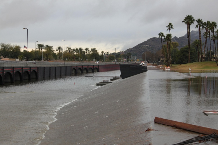 Flooding: Indian Bend Wash in McCormick Ranch  Indian Bend Wash was designed to direct flood waters. The run-off goes through McCormick Ranch Golf Club and crosses Indian Bend Road, in Scottsdale.  By Dru Bloomfield. https://www.flickr.com/photos/athomeinscottsdale/4297108153/in/photolist-7xHNxB-5YXiqH-7xHKHp